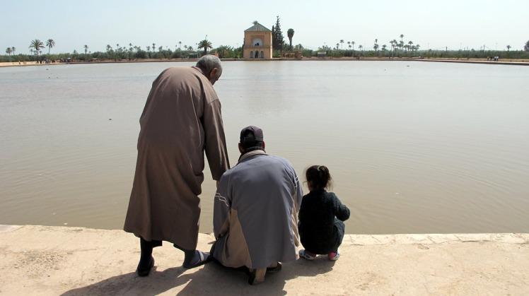 Three generations feeding the fish in Menara Park