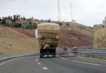 Encountering laden trucks on the mountain roads
