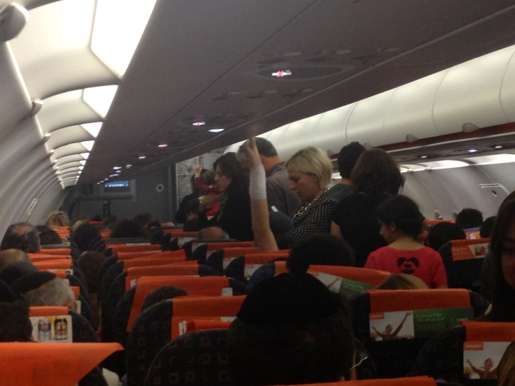 Even before arriving in Israel you get a sense of the place. Party on the plane!