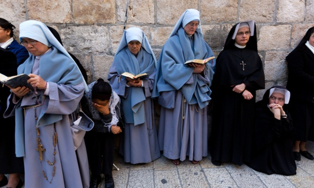 Catholic nuns in prayer facing the Church of the Holy Sepulchre in Jerusalem's Old City