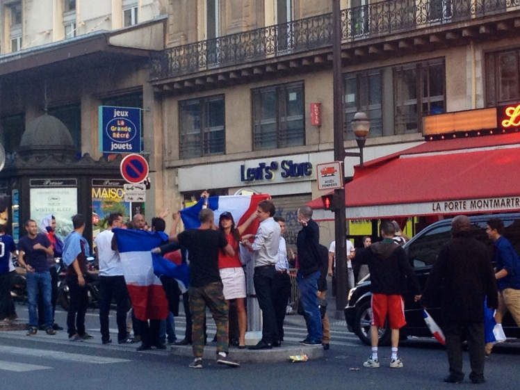 French supporters revelling on the Rue Fauberg-Monmatre in Paris