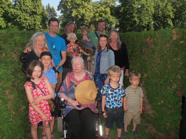Three generations of the Finnish family gather at their mother/grandmother/great gran mother's grave in Helsinki