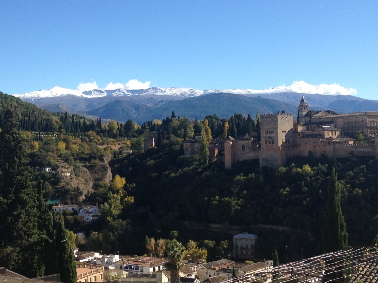 The Alhambra Palace with the Sierra Nevada Mountains as a backdrop